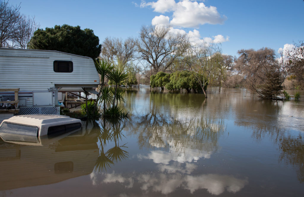 Floodwaters from the Tuolumne River have inundated a trailer park on River Road in Modesto, California. Photo by Dale Kolke / California Department of Water Resources.